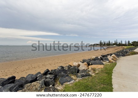 Deserted Scarborough Beach under an approaching storm, Redcliffe Peninsula, Queensland, Australia  - stock photo