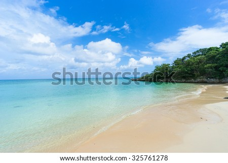 Deserted tropical beach with clear turquoise water, Ishigaki Island National Park of the Yaeyama Islands, Okinawa, Japan - stock photo