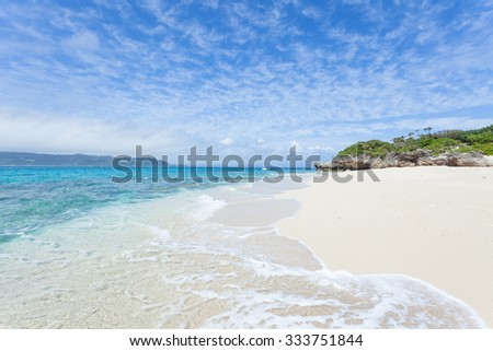 Deserted tropical island beach with clear blue water of a coral lagoon, Okinawa, Japan - stock photo