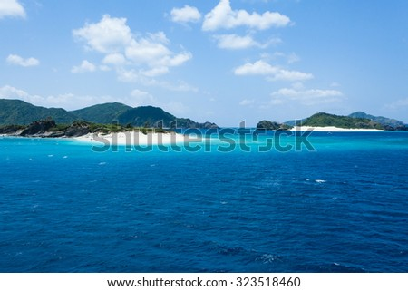 Deserted tropical islands with white sand beach and clear blue water, Kerama Islands National Park, Okinawa, Japan - stock photo