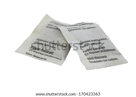 Desiccant drying paper packets isolated on white with clipping path
