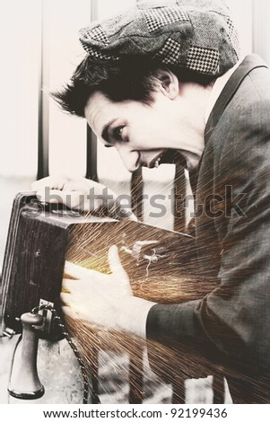 Desiderated Photo Of A Vintage Man Putting His Hand In A Olden Day Wooden Box Telephone To Get A Electric Charge Zap In A Blast From The Past Concept - stock photo