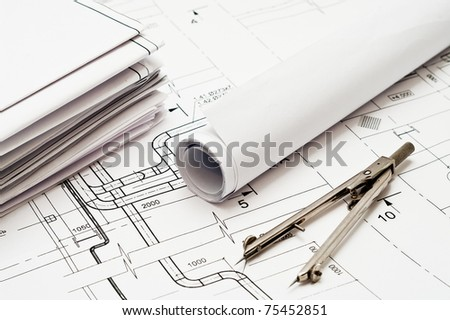 Design and working drawings with pencils and compasses - stock photo