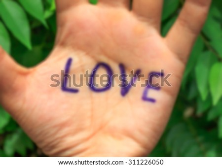 Design blur background word love on hand , tree. - stock photo