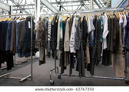 Design clothes hang at  demonstration stand in showroom - stock photo