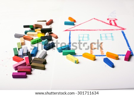 Design Concept for real estate - color dry pastel on a white and wooden background with chalk on a back. - stock photo
