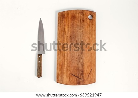 Design concept of mockup cutting board and knife set isolated on white background. Copyspace for text and logo. Clipping Path included on white background.