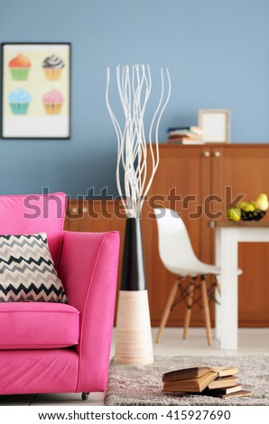 Design interior of living room with pink armchair - stock photo