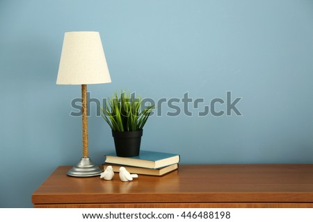 Armchair lamp table home decor on stock photo 609441035 shutterstock design interior with lamp and plant on blue wall background aloadofball Choice Image