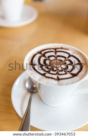 design of chocolate syrup on hot chocolate