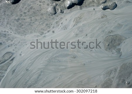 Design of mud and flow pattern in silty stream. - stock photo