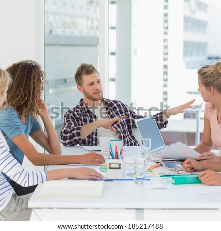 Design team having a meeting together in creative office - stock photo