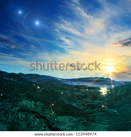design template with emerald water surface and sunset skylight with beautiful clouds - stock photo