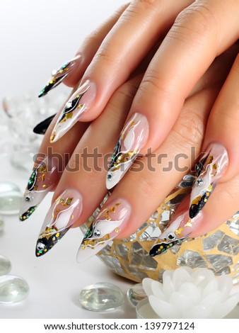 Design women's nails. - stock photo
