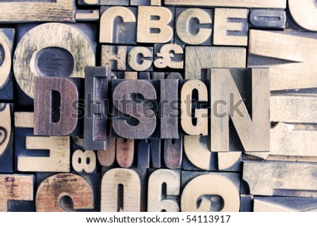 design word made from letterpress blocks with background