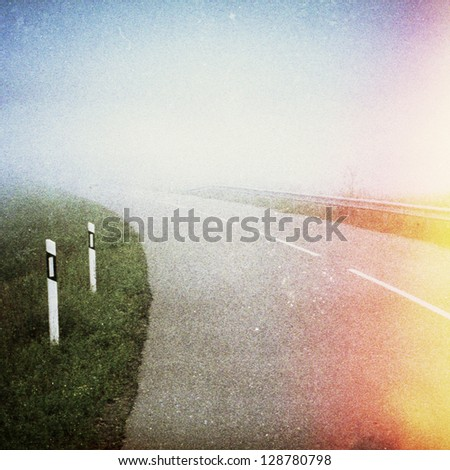 Designed retro photo. Open road. Grain, dust as vintage effect. - stock photo