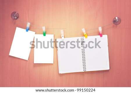 Designer concept - blank photo frames and notebook for your photos - stock photo