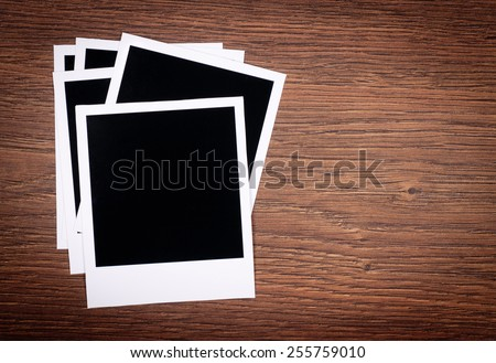 Designer concept - blank photo frames for your photos on wooden background - stock photo