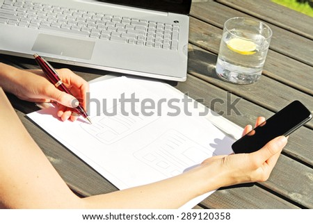 designer drawing a wireframe for mobile web application - stock photo