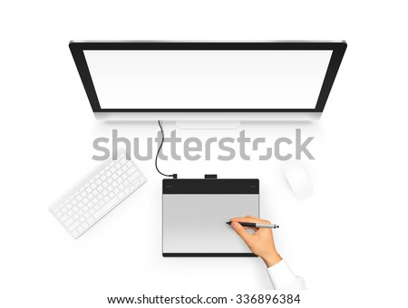 Designer drawing on graphic tablet near pc monitor blank screen. Artist design project with digitizer, stylus, computer, mouse and keyboard. Empty display monoblock from above. Creative workplace top  - stock photo