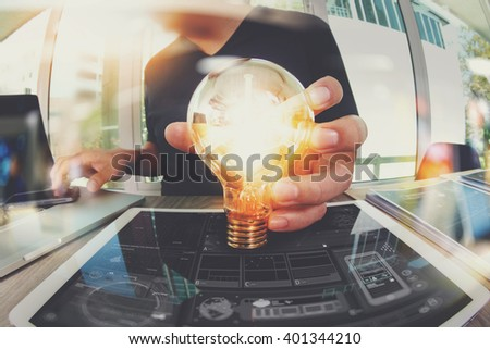 designer hand showing creative business strategy with light bulb as concept - stock photo