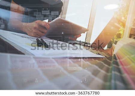 Designer hand working with laptop computer and smart phone and digital tablet with digital design diagram layer on wooden desk as responsive web design concept - stock photo