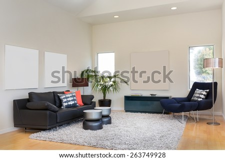 Designer launching chair and couch with pillow and lamp. Living room interior with copy space for art or poster with hand-woven natural colored fine sisal rug open space living room within nature. - stock photo