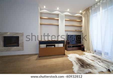 Designer living room with fireplace - stock photo