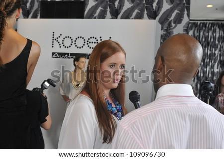 Designer Nikki Silverthorne gives interview at the Kooey 2013 Swimwear Presentation during Mercedes-Benz Swim Fashion Week on July 21, 2012 in Miami, FL - stock photo