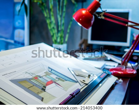 Designer's desk with computer and equipment - stock photo