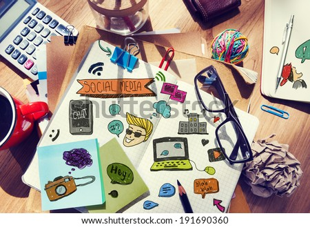 Designer's Table with Social Media Notes and Tools - stock photo