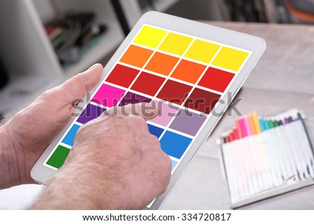 Designer using a tablet with a color palette