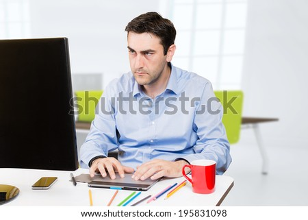 Designer working on tablet in the office