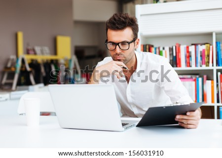 Designer working with laptop - stock photo