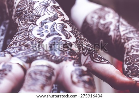 designing mehandi is applied on both hands, celebration concept - stock photo