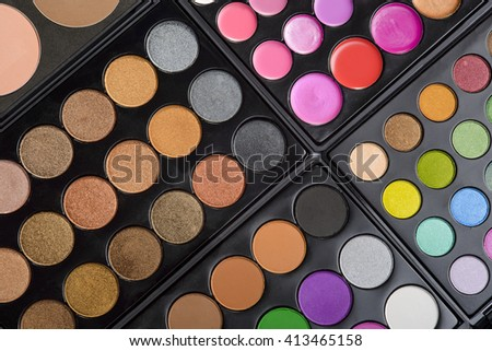 Desirable set for make-up made of the variety of palettes with eyeshadows and lipstick. Very colorful picture for wallpaper. Positive shades of cosmetic to feel happy. - stock photo