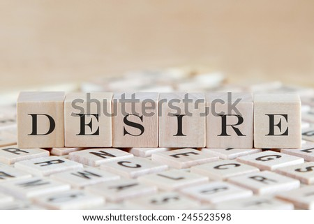 desire word on wood blocks