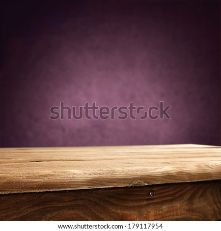 desk and red wall  - stock photo