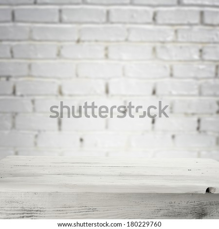 desk and white wall bricks  - stock photo