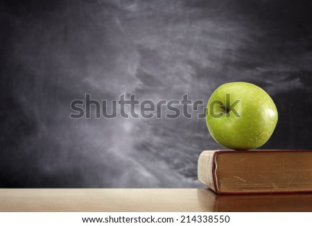 desk apple and book  - stock photo
