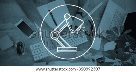 desk lamp against man working at his desk and typing on keyboard