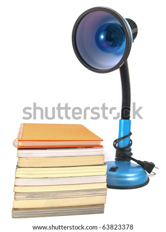 desk lamp and book heap isolated on white background