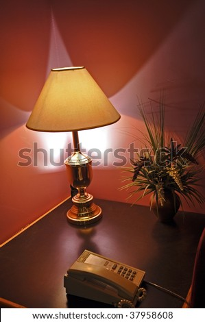 desk lamp and telephone