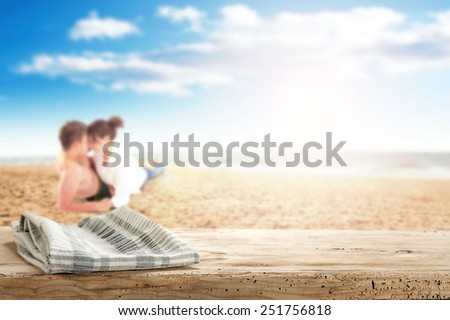 desk napkin and lovers on tropical beach