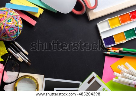 Desk of an artist with lots of stationery objects