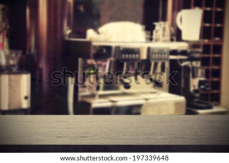 desk of black shadows and cafe machine on background  - stock photo