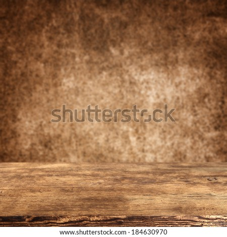 desk of brown and brown wall in dirty color  - stock photo