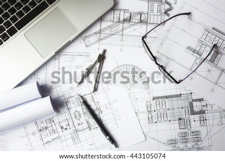 Desk of Engineering project in construction site or office. Construction concept.Engineering tools.Vintage tone retro filter effect,soft focus(selective focus) - stock photo