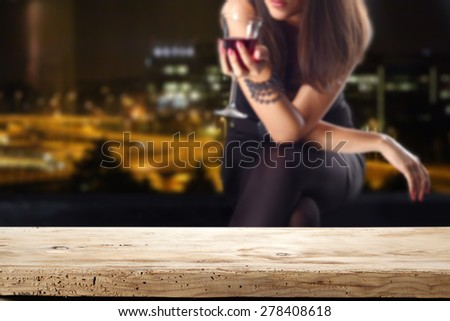 desk of free space and woman with wine