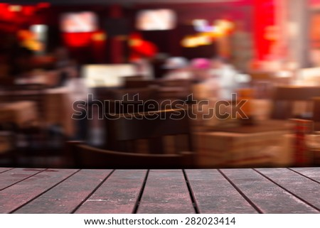 desk of old brown wood in restaurant - stock photo